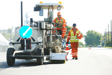 workers at road surface pavement markings
