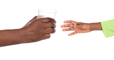 Hands holding glass