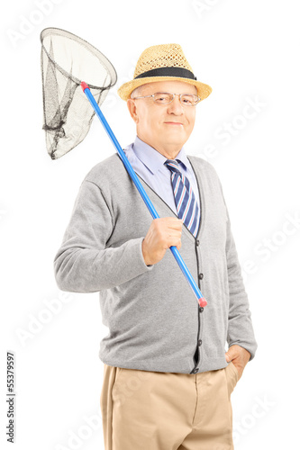 Smiling mature gentleman posing with a butterfly net