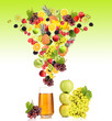 Diffferent fruits and berries falls into glass of fresh juice,