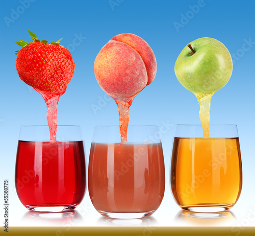 Fresh juice pours from fruits and strawberry into a glasses,