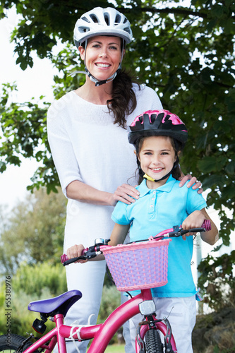 Mother And Daughter On Cycle Ride In Countryside