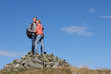 Walkers Standing On Pile Of Rocks