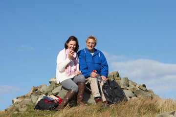 Senior Couple Stopping For Lunch On Countryside Walk