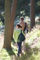 Couple On Country Walk Through Woodland