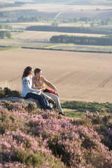 Couple Stopping For Lunch On Countryside Walk