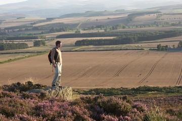 Man Admiring View On Countryside Walk