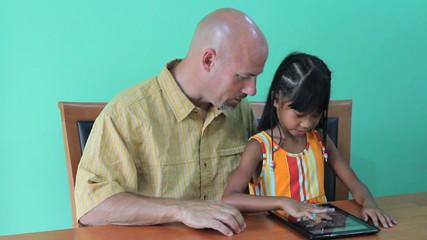 Asian Girl Having Fun On Digital Tablet