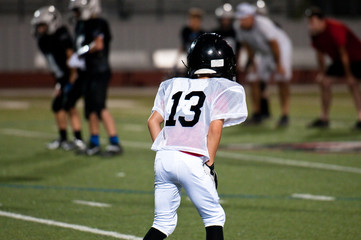 Young american football player in position
