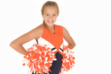 Young girl cheerleader standing with pompoms