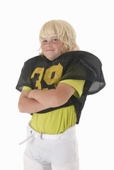 Boy in American football uniform with black and yellow jersey