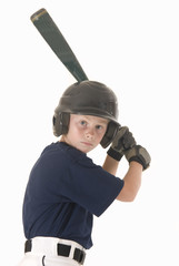 Boy in baseball helmet with bat