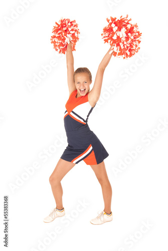 Young girl cheerleading orange pompoms