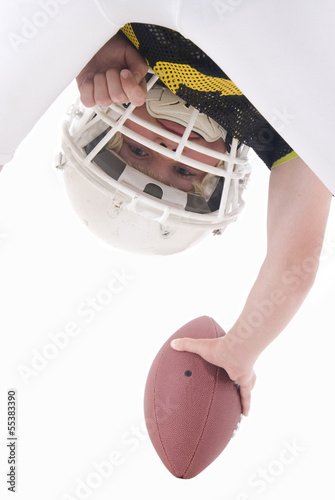 American football player hiking ball