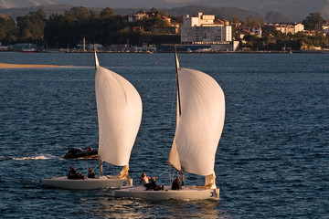 Training of two sailboats in Atlantic sea