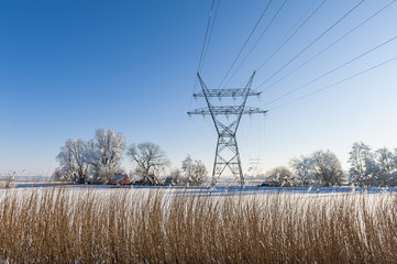 Electricity Pylon in Dutch winter landscape