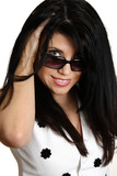 Beautiful woman smiling looking over sunglasses