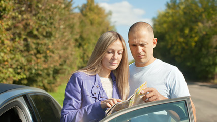 couple looking at the map on the road