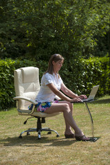Garden office woman working outside during summer