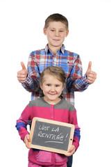 Happy children holding a slate
