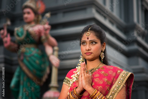 Young Indian woman praying - 55388518