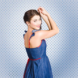 Young caucasian woman posing in retro denim dress