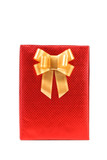 Red present box with spots and golden bow.