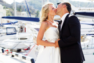 Young couple in love posing on the background of sea