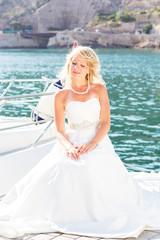Beautiful bride posing near the sea