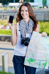 young woman tourist holding map and phone