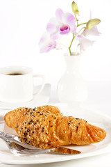 Delicious croissant with a cup of black coffee