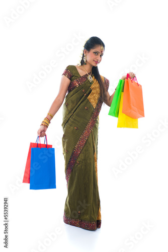 traditional South Indian woman holding Deepavali shopping bags a