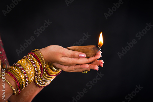 hand holding lantern during diwali festival of lights