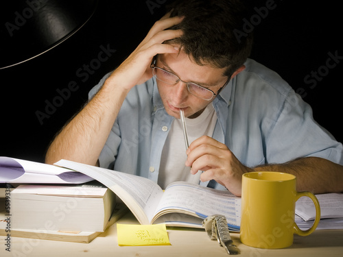 Young Man Studying at Night