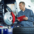Master mechanic checking repair details