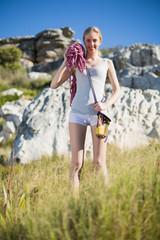 Blonde woman holding climbing equipment