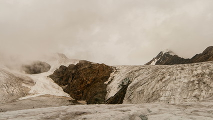 Mountain tops with snow, glacier and clouds