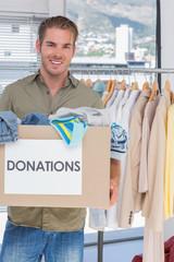 Volunteer holding donation box