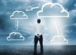 Businessman considering cloud computing graphics