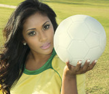 Female soccer coach player holding ball