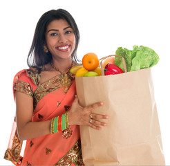 Indian woman having groceries shopping