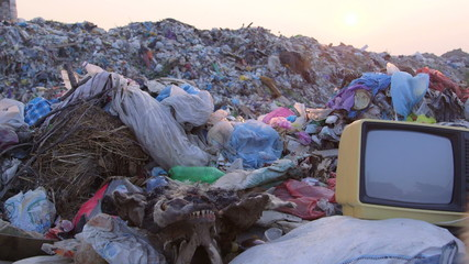 Old TV In Landfill At Sunset