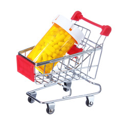 pill bottle in shopping cart isolated. concept