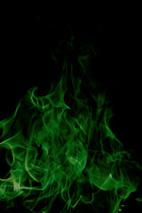 green fire on black background