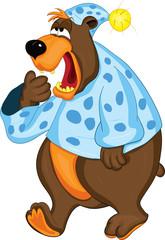 Медведь в пижаме прикрывает пасть лапой