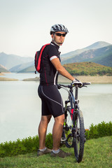 Mountain biker beside a beautiful lake