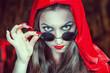 Beautiful halloween woman in black glasses