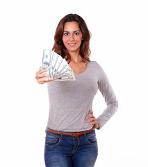 Smiling woman holding cash dollars while standing