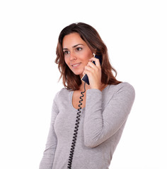 Stylish hispanic woman talking on phone