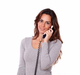 Stylish young female talking on phone